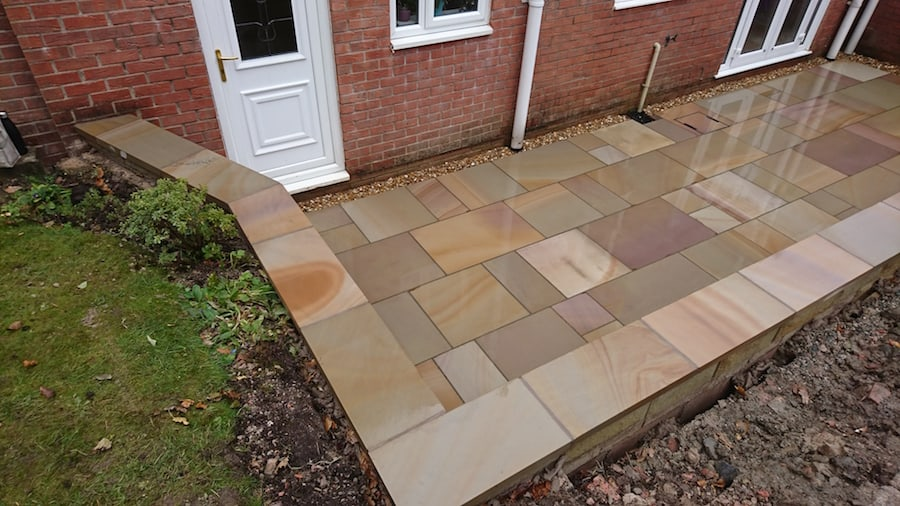 Four Sawn Indian Stone Flags With Natural Stone Wall
